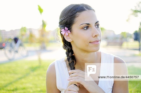 Portrait of attractive young spanish woman in nature