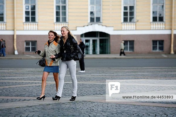 Young women walking at the Palace Square St Petersburg  Russia