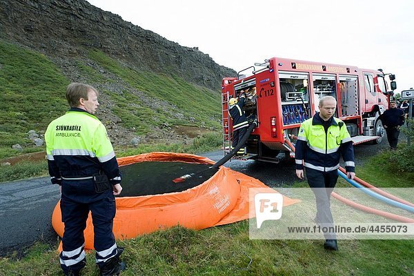 Firemen and ambulance workers on the scene of a summer house fire  South Iceland