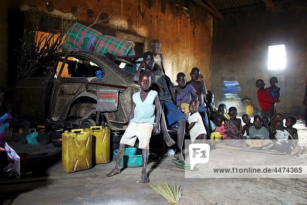 refugees have have fled into an old factory The fighting in Uganda between the rebel force Lord Resistance Army or LRA and the Ugandan army UPDF has resulted in 100 thousands of displaced people in the north of uganda The population is weak  sick and m