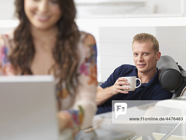 Couple at home relaxed  shopping online