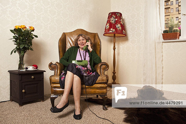 A senior woman on the phone at home