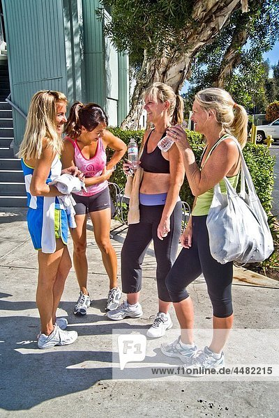 Attired for an excercise session  four athletic woman meet outside a gymnasium in Laguna Niguel  CA Note Hispanic in center