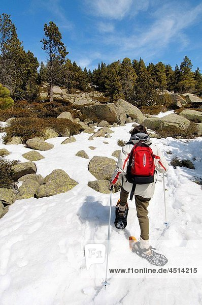 Woman with snowshoes. Area Meranges lakes. Meranges  comarca of Cerdanya. Girona. Catalonia. Spain.