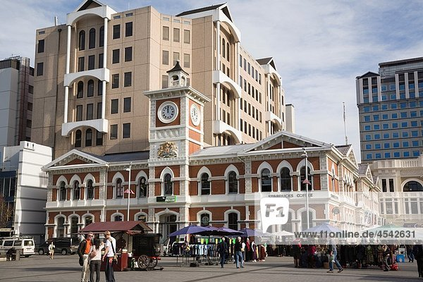 Christchurch Canterbury South Island New Zealand Old Post Office building 1879 and clock tower in Cathedral Square in city centre busy with people Now tourist information centre