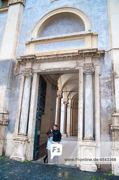 Couple together outside a Roman Landmark in Rome  Italy