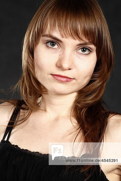 closeup portrait of a young adult woman blank expression