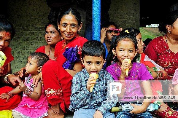 Children having ice cream on the day of Teej festival at Pachali Bhairab Temple  Kathmandu Nepal Children having ice cream on the day of Teej festival at Pachali Bhairab Temple, Kathmandu Nepal