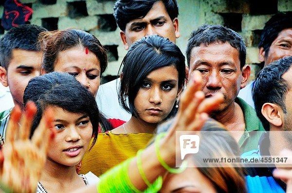 Girl looking at the people dancing on the day of Teej festival  Kathmandu Nepal
