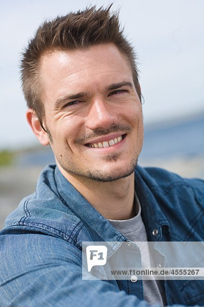 Portrait of man smiling outdoors