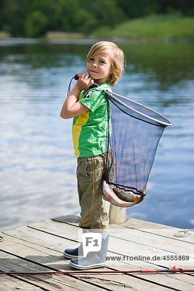 Fisch Pisces Junge - Person fangen halten Netz