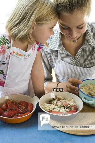 Sisters preparing food together