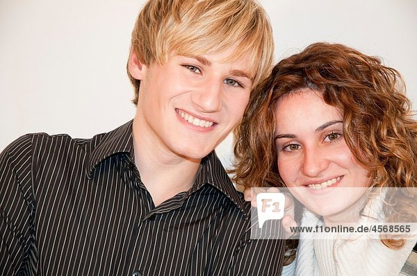 Young couple smiling and looking at the camera. Close view.