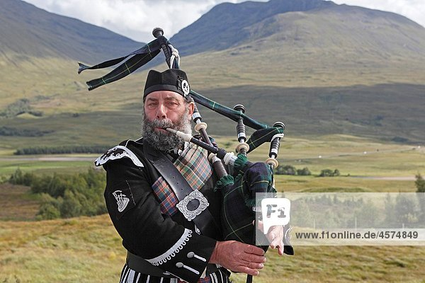 Bagpipe player Scotland.