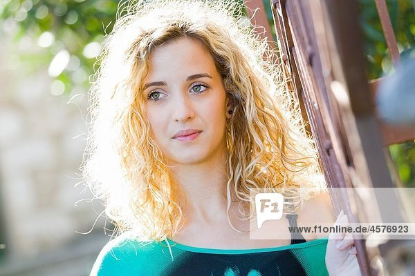 Daydreaming young blonde woman portrait