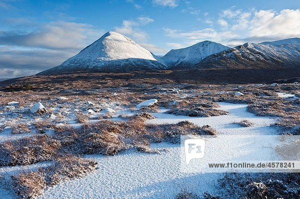Winter view of snow covered landscape and Red Cuillin hills  Isle of Skye  Scotland