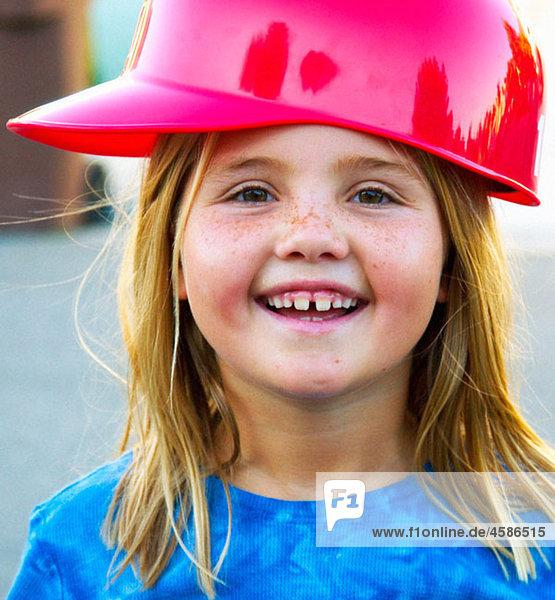 girl with baseball helmet