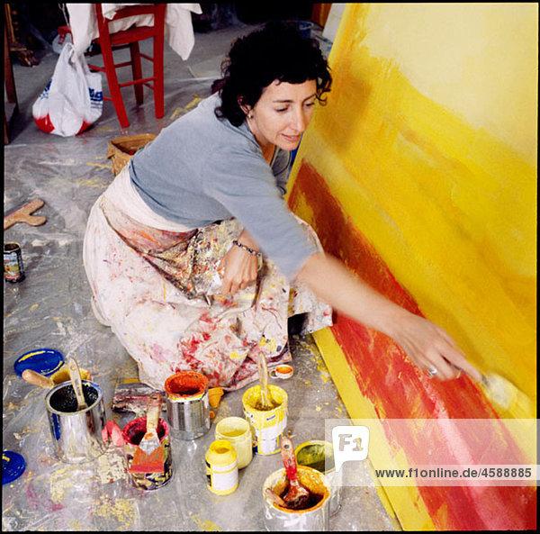 Painter in her workshop.