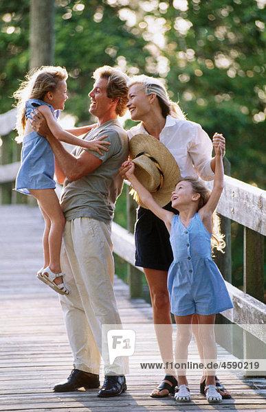 family enjoying sn outdoor walk