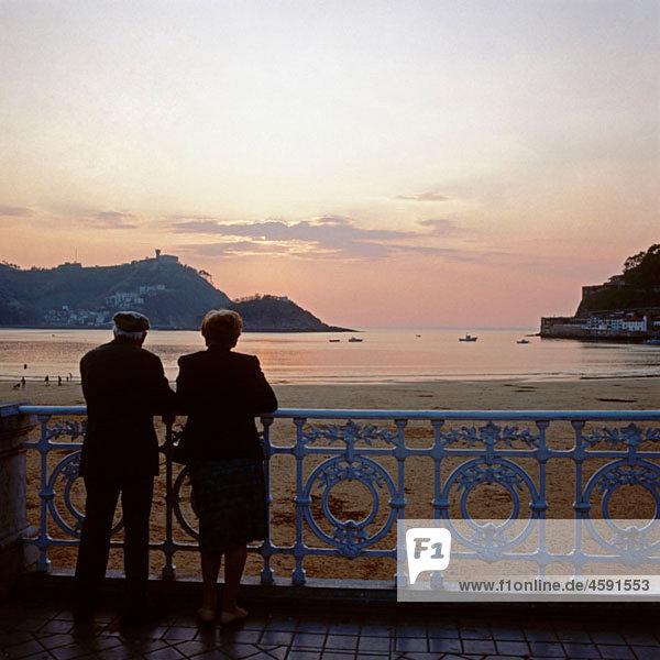 Elderly couple looking to San Sebastian Bay. Guipuzcoa  Basque Country  Spain
