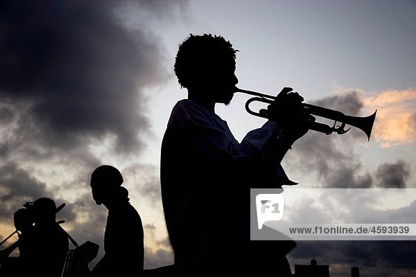 Trumpet player in El MalecÛn in the evening. Havana. Cuba