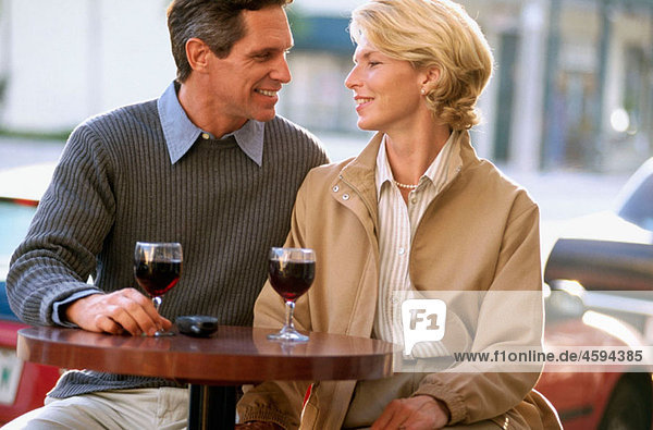 cafe couple having a glass of wine
