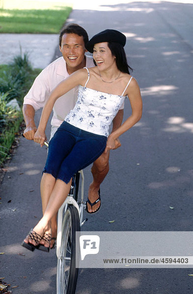 couple riding on a bicycle