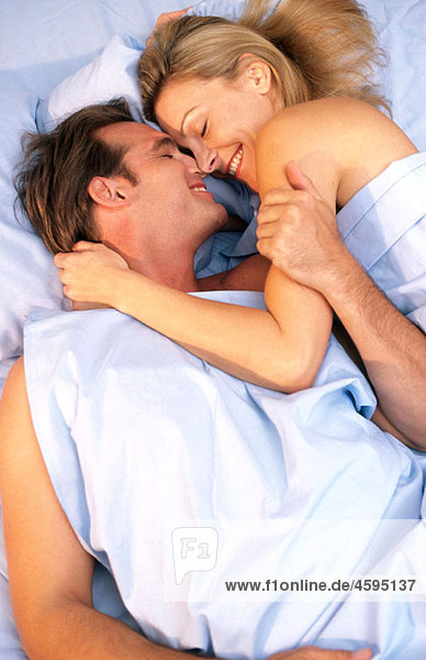 romantic/playful couple in bed