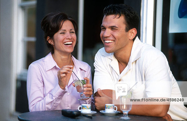 couple laughing at a cafe