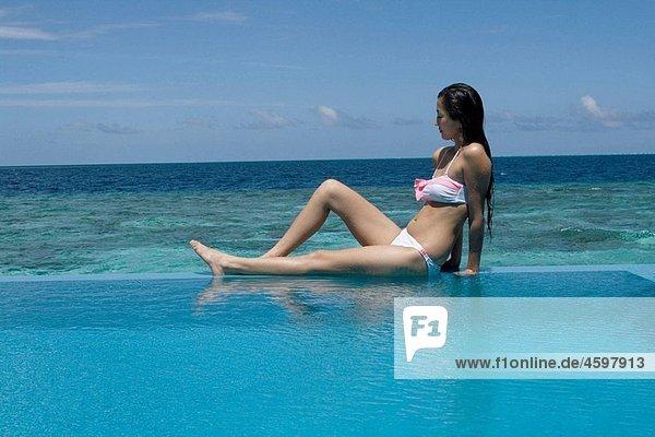 Woman on swimmingpool  Maldives  Indian Ocean