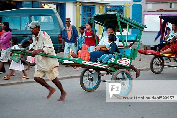 Madagascar. Antsirabe. Pousse-pousse  the local taxi.