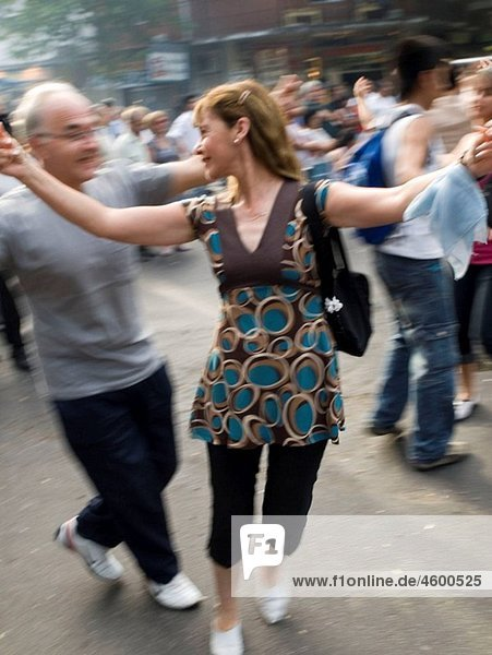 People dance in the street at a dance festival in Buenos Aires  Argentina