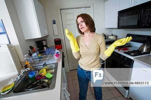 Young woman posing in her kitchen