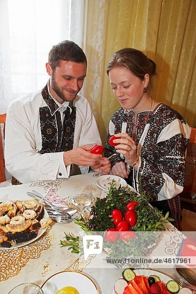 Romania Moldavia Region Southern Bucovina near Campulung Easter Monday Celebration traditional breakfast traditional costumes folklore painted Easter eggs