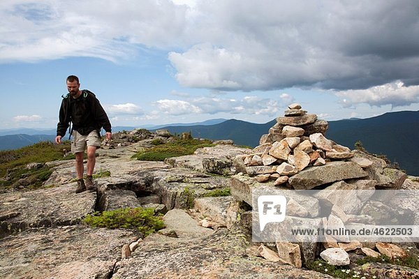 Pemigewasset Wilderness - A hiker on the summit of Bondcliff during the summer months Located in the White Mountains  New Hampshire USA