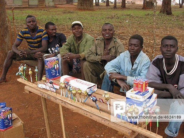 A group of men selling by the road Feeding centres and other humanitarian aid were organised in Angola after widescale malnutrition during and following the country¥s civil war