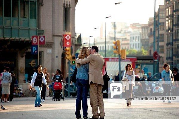 Couple kissing  Barcelona  Catalonia  Spain