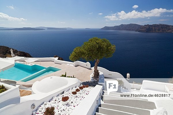 Greece  Cyclades  Thira  Santorini  Oia  View of stairs with pool and olive tree