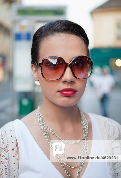 Croatia  Zagreb  Young woman with necklace  portrait