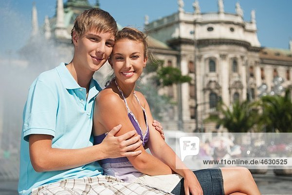 Young man and woman smiling  portrait