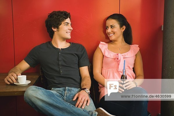 Germany  Munich  Young couple in cafe  smiling