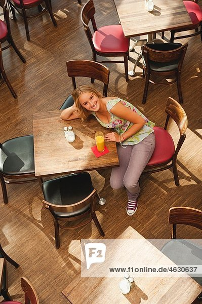 Teenage girl in cafe  smiling  portrait