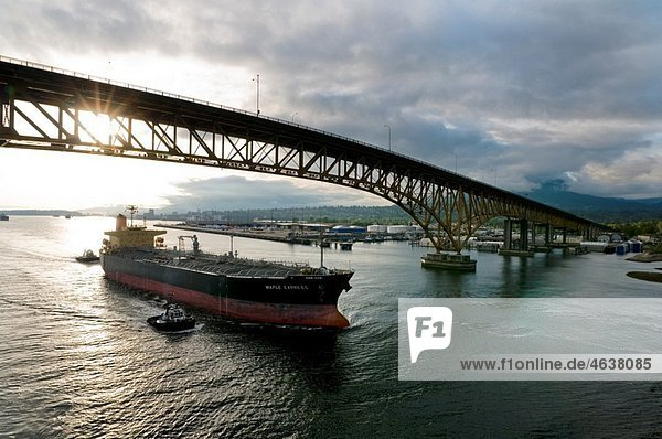 Canada  BC  Vancouver Freighter is escorted under the Second Narrows bridge on the Burrard Inlet by harbour tugs