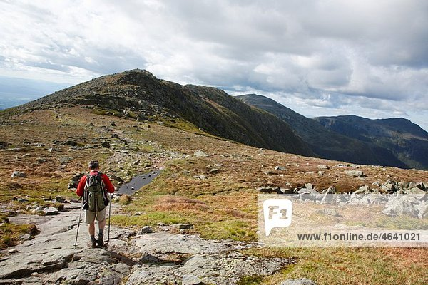 A hiker on the Appalachian Trail descending Mount Washington Located in the White Mountains  New Hampshire USA Notes: Mount Washington is famous for the highest wind gust ever measured on earth at 231 miles per hour on April 12  1934