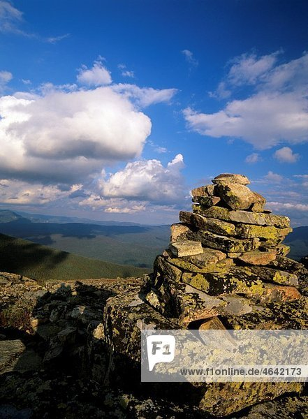 Scenic views from Bondcliff with an rock cairn in the foreground Located on the Bondcliff trail in the Pemigewasset Wilderness  which is in the White Mountain National Forest of New Hampshire  USA
