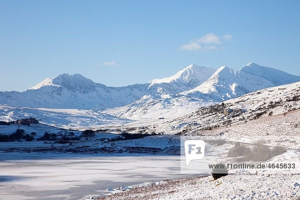 Capel Curig  North Wales  UK  Europe View across Llynnau Mymbyr frozen lakes to the Snowdon horseshoe in Snowdonia National Park with deep snow in winter