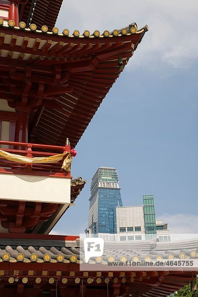 Chinatown Outram Singapore Buddha Tooth Relic Temple BTRTS building detail with modern skyscrapers beyond Buddhist Mandala in Chinese Tang Dynasty style architecture Dedicated to The Maitreya Buddha or The Future Buddha