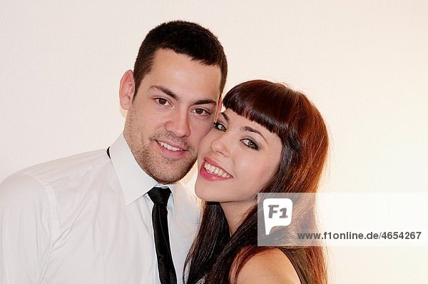 Young couple smiling and looking at the camera