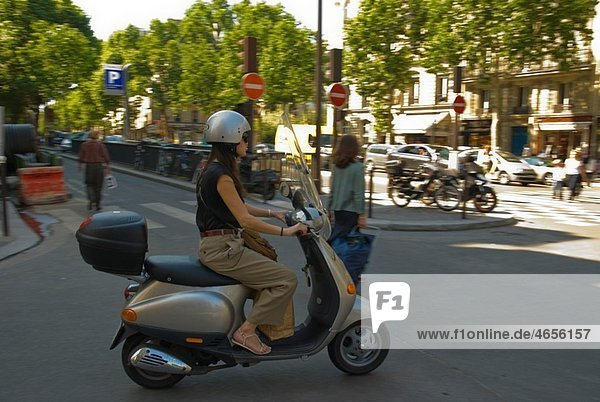 Woman on scooter St-Germain-des-Pres Paris France Europe