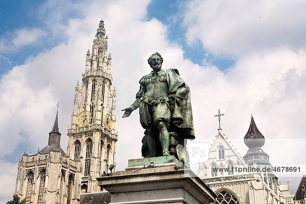 Rubens´ statue in front of the tower of the Cathedral  built between XIV Century and XVI Century  in Antwerp Belgium